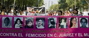 "A group of women hold a banner with pictures of victims during a demonstration against violence to women in Mexico City, on November 29, 2008. Last November 25 the ""Stop Violence Against Women"" day was celebrated in Mexico. According to NGO's reports, in the last 18 months 1,014 women have been killed --most of them in domestic violence cases. AFP PHOTO/Alfredo Estrella (Photo credit should read ALFREDO ESTRELLA/AFP/Getty Images)"