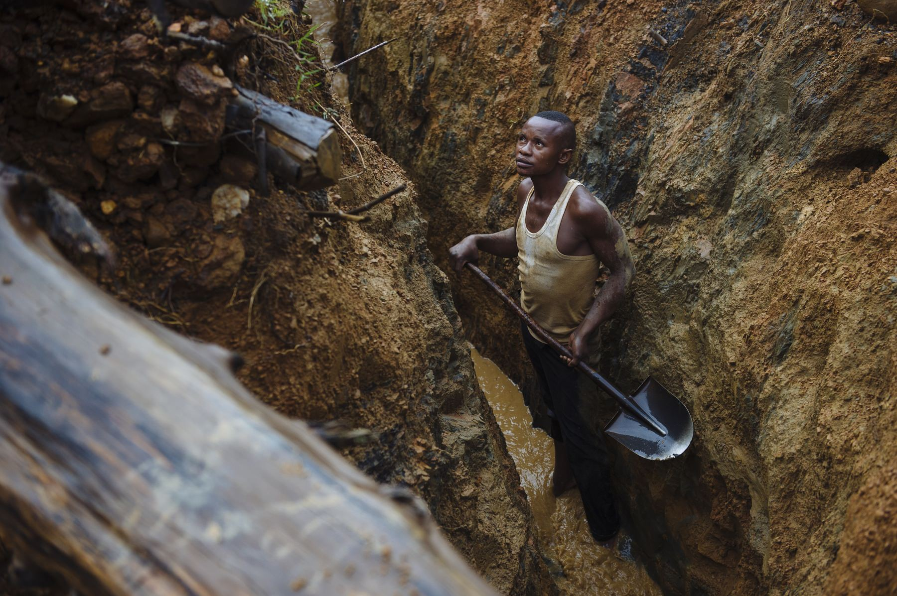 A digger works in a channel cutting through the Mufa II artisanal gold mining site in South Kivu, in the east of the Democratic Republic of the Congo on April 11, 2015. The site is not in an artisanal mining zone, so miners working here are technically doing so illegally.